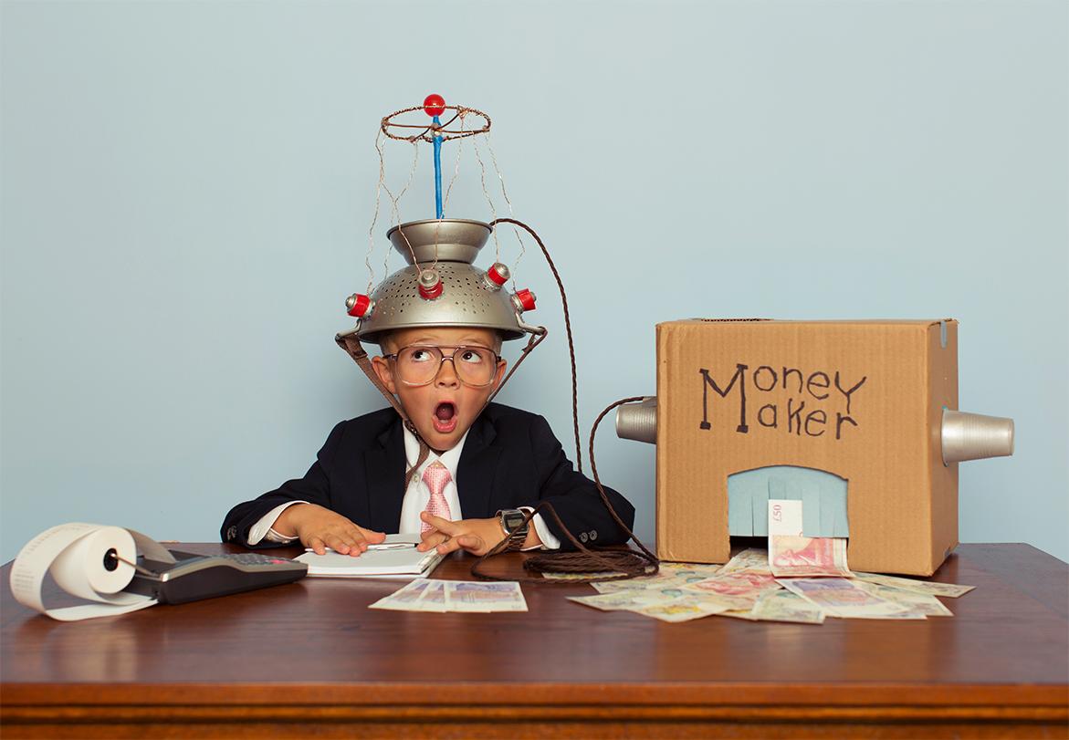 Boy with a money maker box