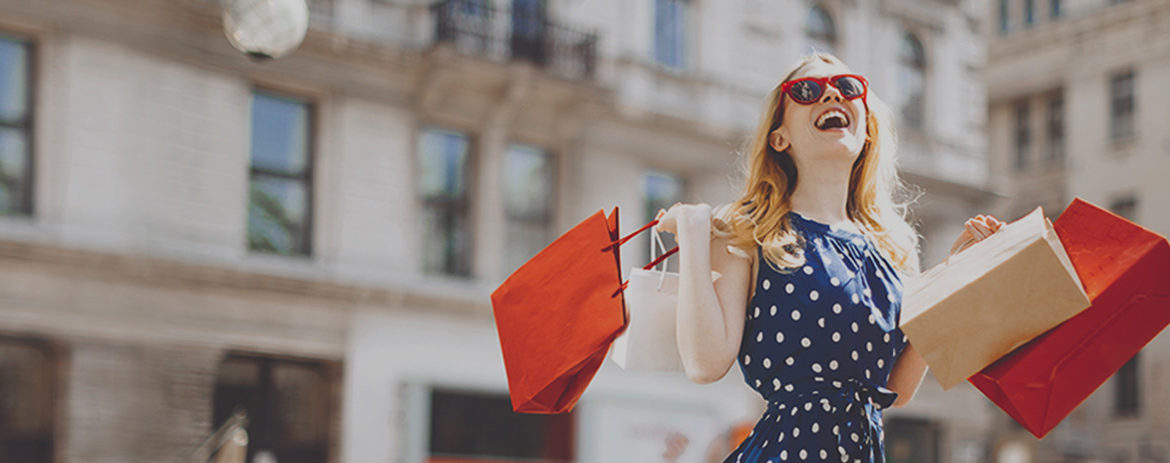 Lady in square holding shopping bags