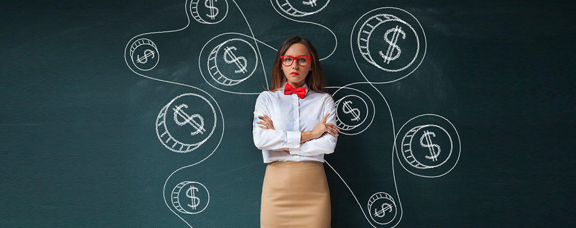 Young girl standing in front of blackboard with dollar signs