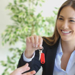 Lady handing over keys to house