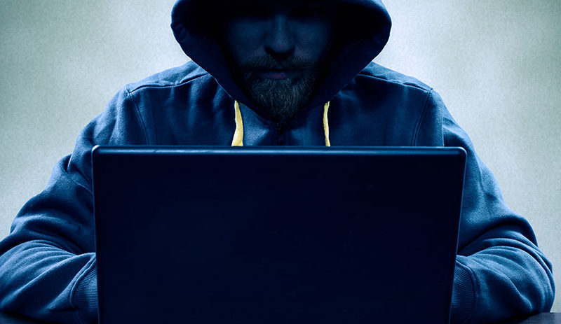 Suspect man on laptop